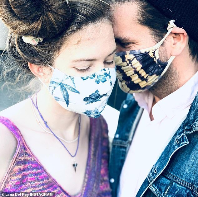 The couple: One of the photos in Lana's gallery showed her with her new fiancé, Clayton Johnson, touching their foreheads with beautifully patterned face covers.