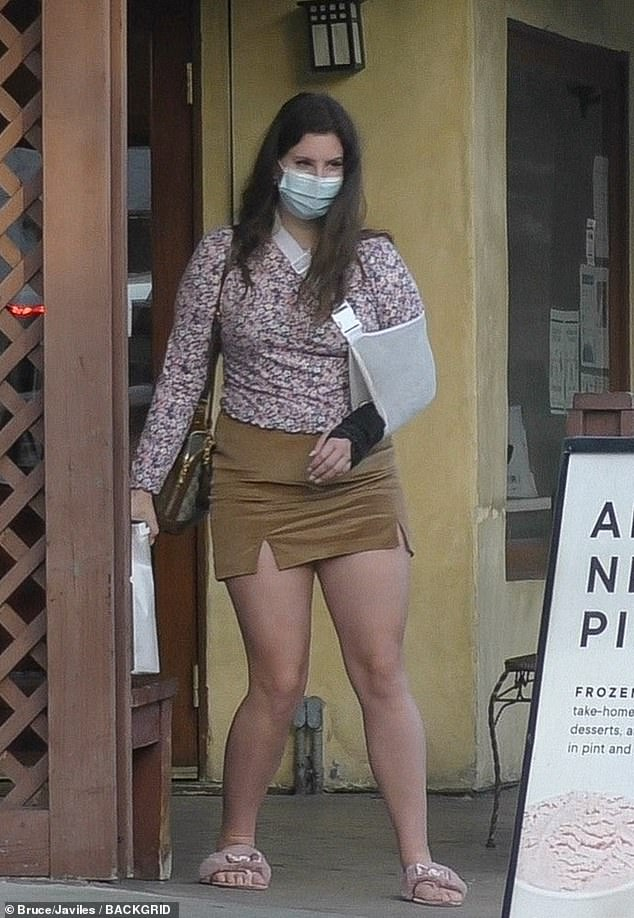 Her arm is still in a sling: Lana Del Rey is spotted in Studio City on Sunday grabbing takeaways from Il Tramisino, an Italian restaurant.