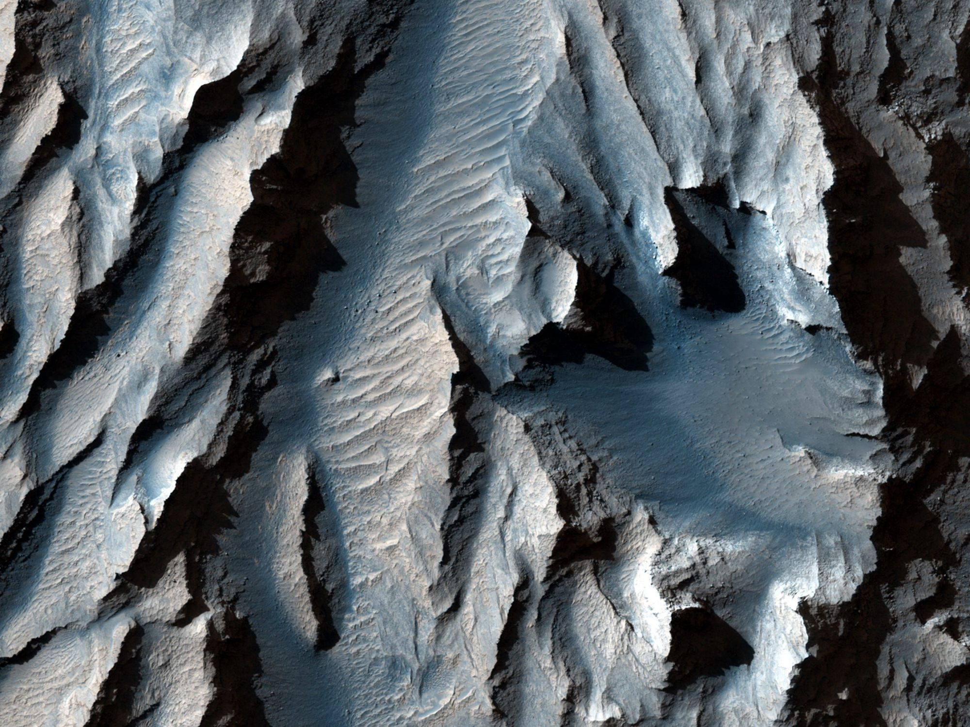 NASA says the new images reveal a huge valley on the surface of Mars, the largest in the solar system