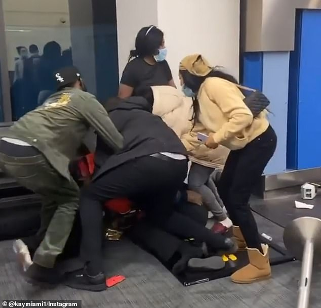 A fight erupted after a dispute over a suitcase at Detroit Metro Airport